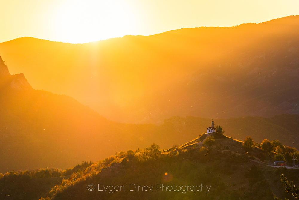 Златен родопски залез над храма